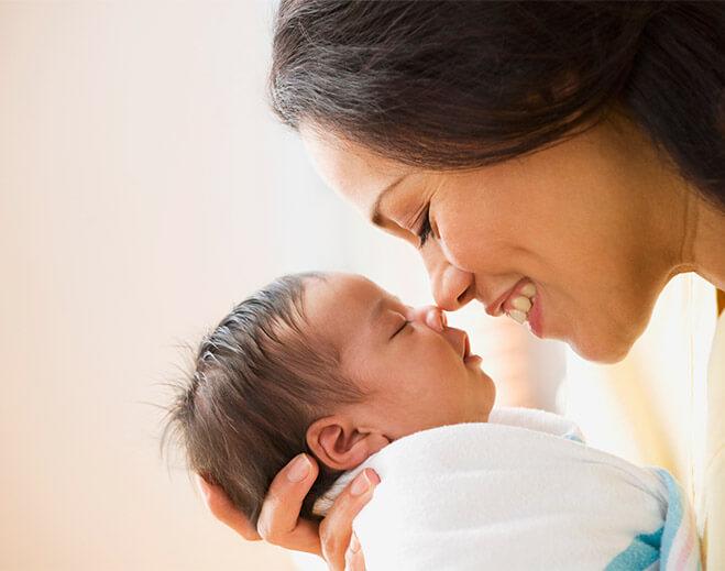newborn nose touching mom's nose