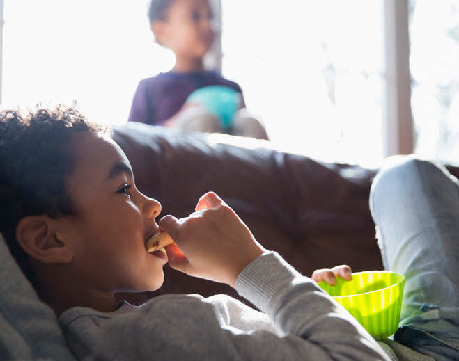 Boy eating cookie